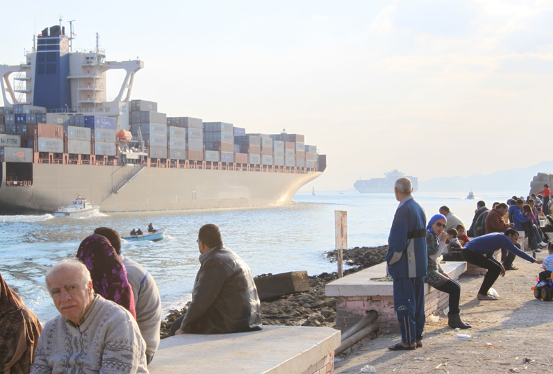 A cargo ship passes through the Suez Canal in the city of Suez. Photo by Emily Smith. All rights reserved.