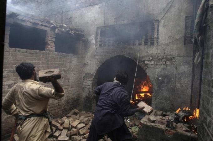 Angry mobs attack Christian homes in Lahore, Pakistan, March 9, 2013. (AP Photo/K.M. Chaudary)