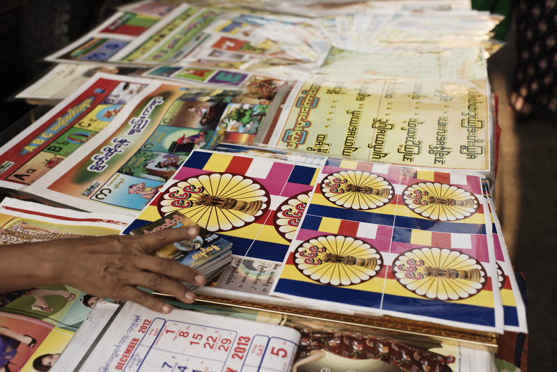 969 stickers displayed for selling in a street stall in downtown Yangon. Photo by Vincenzo Floramo.