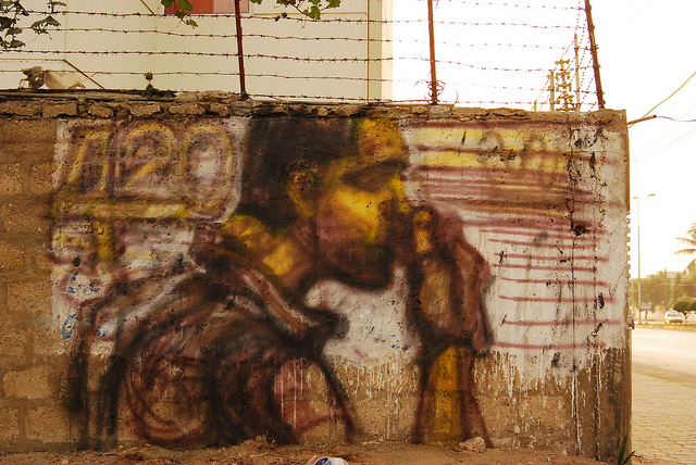 "Asim Butt, ""Something Rotten in the State,"" (2009), unfinished. Spray paint graffiti. Sunset Boulevard, Karachi. Photo courtesy Mohatta Palace Museum."