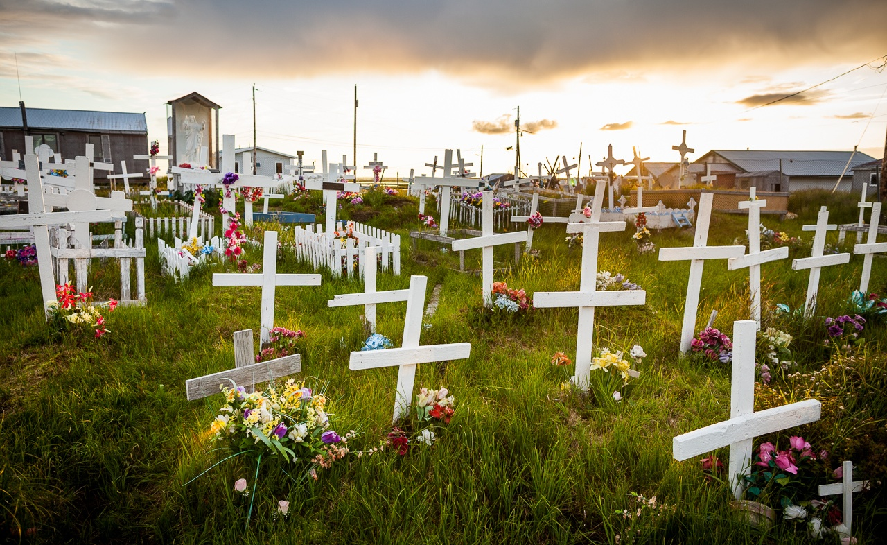 """Simple wooden crosses mark the grave sites at an indigenous cemetery in Chefornak."" Photo by Loren Holmes for The Atlantic"