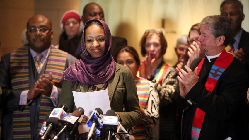 Wheaton College professor Larycia Hawkins is greeted with applause from supporters as she begins her remarks during a news conference on Dec. 16, 2015, in Chicago. (Brian Cassella / Chicago Tribune)